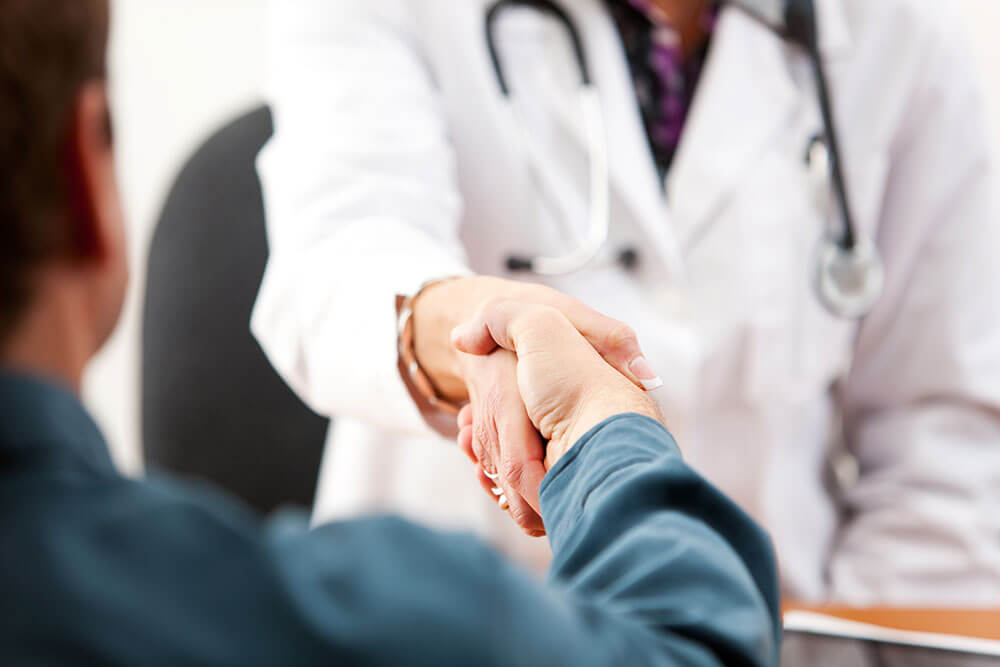 doctor shaking hands with a male patient